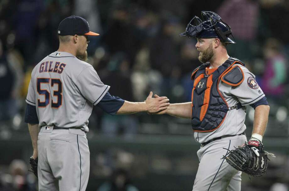 SEATTLE, WA - APRIL 11: Catcher Brian McCann #16, right, of the Houston Astros congratulates relief pitcher Ken Giles #53 of the Houston Astros after game against the Seattle Mariners at Safeco Field on April 11, 2017 in Seattle, Washington. The Astros won the game 7-5. Photo: Stephen Brashear, Getty Images / 2017 Getty Images