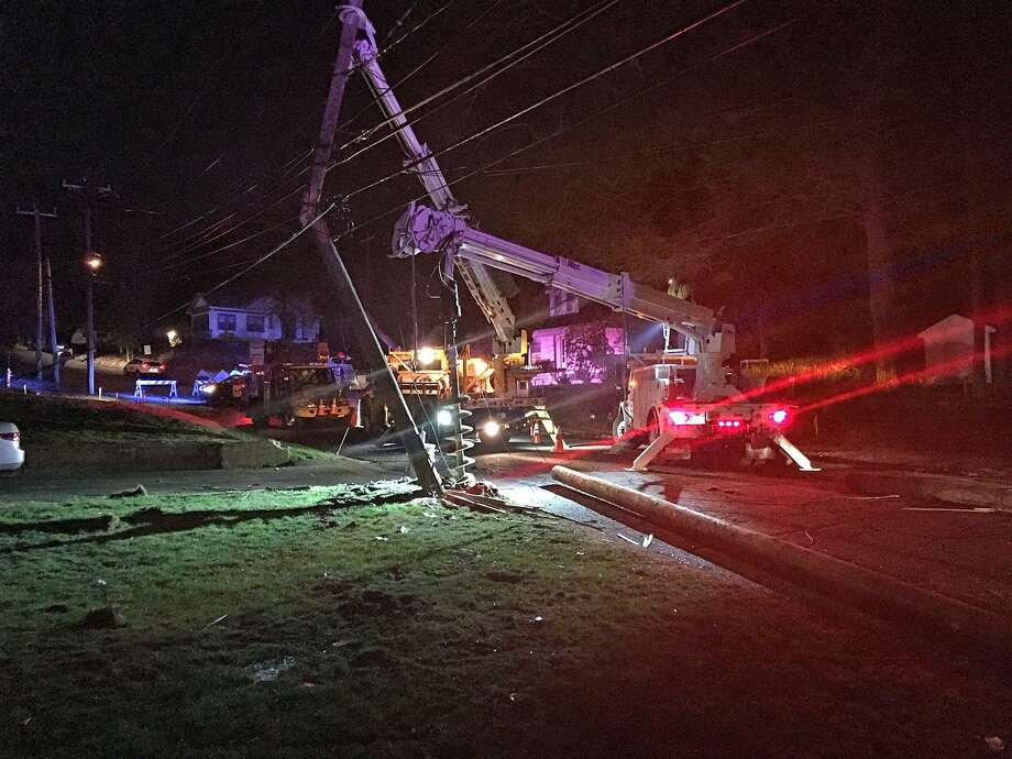 Eversource crews work to restore power after a crash on Rimmon Street in Seymour killed one person and injured several others on Tuesday, April 11, 2017. Photo: Jim Shay / Hearst Connecticut Media / Connecticut Post