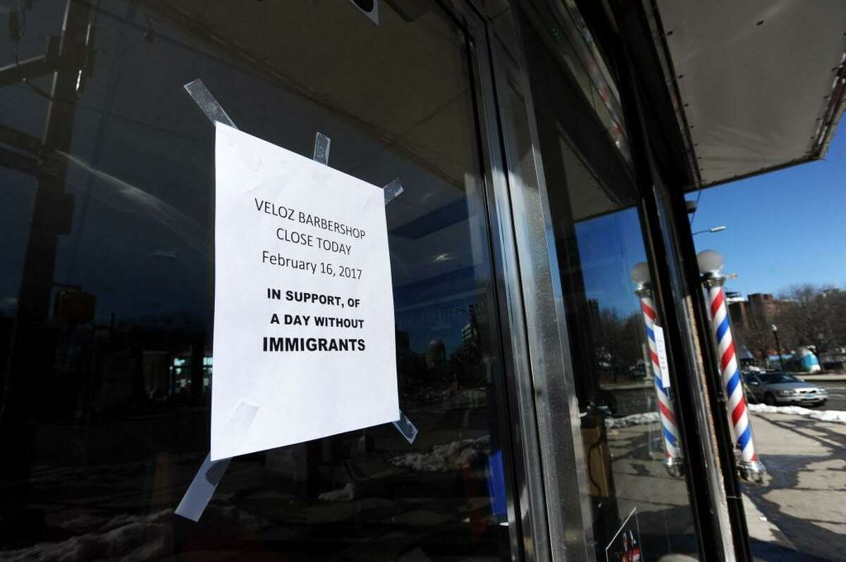 """FILE - Veloz Barbershop closed for the day in solidarity with the """"A Day Without Immigrants Protest"""" in Stamford, Conn. on Thursday, Feb. 16, 2017."""