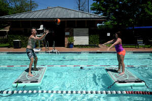 Trevor Batson and Chelsey Wigginton toss a medicine ball on BOGA FitMats at the Christus Health and Wellness Center. Users engage their core muscles to keep their balance while exercising on the floating mats.  Photo taken Wednesday 4/5/17 Ryan Pelham/The Enterprise
