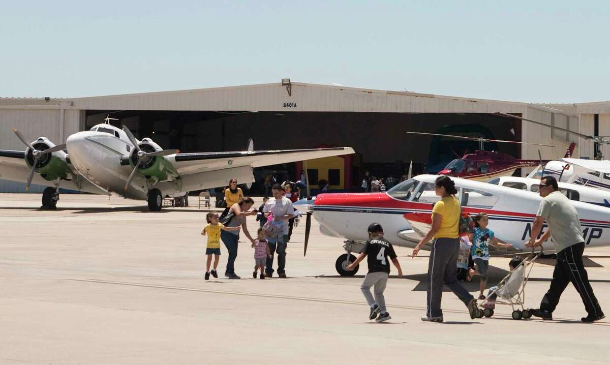 Families walk the tarmac during HobbyFest at Hobby Airport