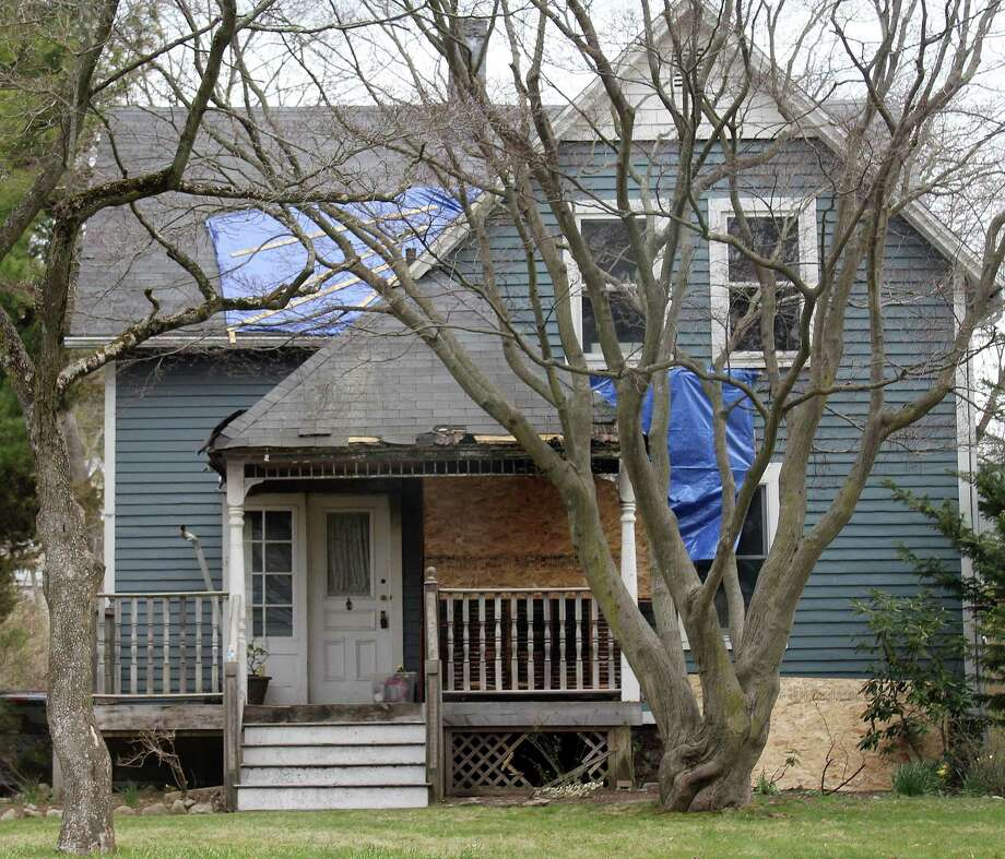 On April 6, fire crews in Darien battled a fire at a house on Holmes Avenue. Photo: Erin Kayata / Hearst Connecticut Media / Darien News