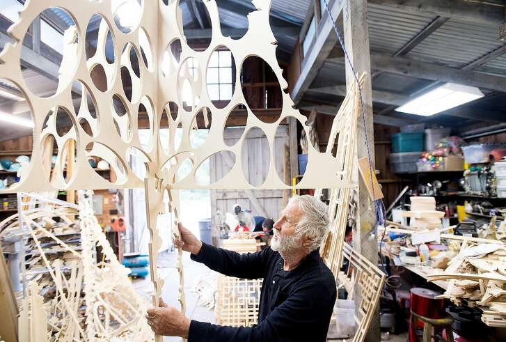 "David Best arranges pieces for his ""Temple Bar"" art installation at his Petaluma, Calif., workshop on Tuesday, April 11, 2017. He'll display the piece during the San Francisco Art Institute's spring gala."