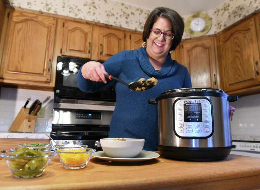 Elizabeth Barbone uses her Instant Pot to make chicken burrito bowls in her kitchen Thursday April 6, 2017 in Troy, NY. (John Carl D'Annibale / Times Union)