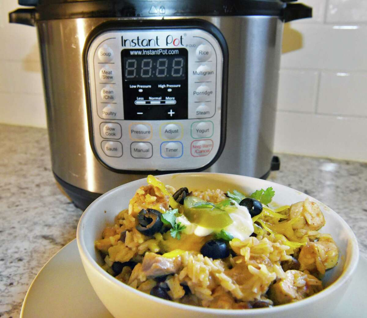 Elizabeth Barbone's Instant Pot to chicken burrito bowls Thursday April 6, 2017 in Troy, NY. (John Carl D'Annibale / Times Union)