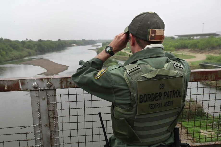 A U.S. Border Patrol agent scans the U.S.-Mexico border while on a bridge over the Rio Grande on March 13, 2017 in Roma, Texas. Photo: John Moore, Getty Images / 2017 Getty Images