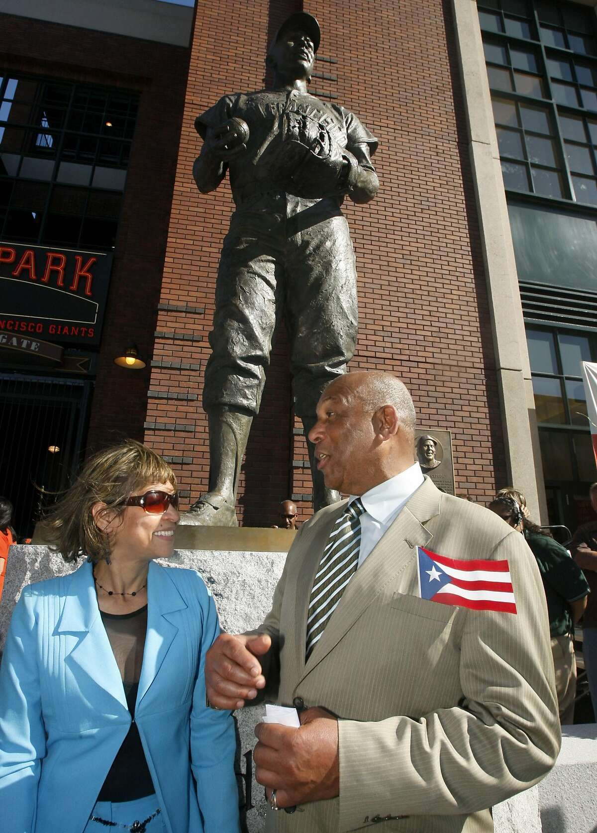 Hall of Famer Orlando Cepeda and his wife Miriam stand below his statue that the San Francisco Giants formally dedicated at AT&T Park in San Francisco, Calif., on Saturday, Sept. 6, 2008.