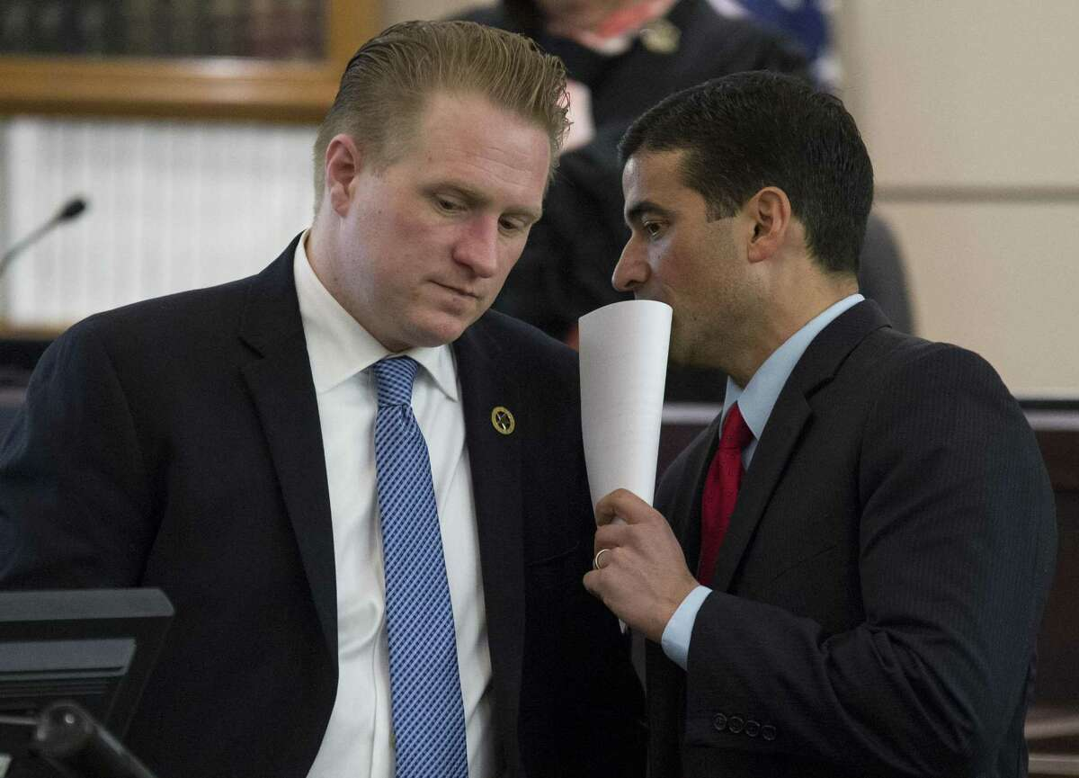File Photo-Bexar County District Attorney and lead prosecutor Nico Lahood, right, confers with prosecutor Jason Goss during the trial of Miguel Martinez for the January 2015 murder of Laura Carter, Wednesday, Feb. 8, 2017, in the 437th District Court in San Antonio. (Darren Abate/For the San Antonio Express-News)