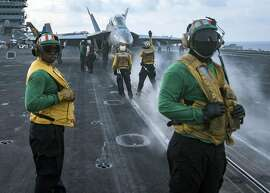 In a photo provided by the U.S. Navy, sailors conduct flight operations on the flight deck of the aircraft carrier USS Carl Vinson in the South China Sea on April 8, 2017. China�s leader, Xi Jinping, and President Donald Trump spoke by phone on Wednesday about the escalating tensions with North Korea as a prominent Chinese state-run newspaper warned the North that it faced a cutoff of vital oil supplies if it dared test a nuclear weapon. (Spc. 3rd Class Matt Brown/U.S. Navy via The New York Times) -- FOR EDITORIAL USE ONLY. --