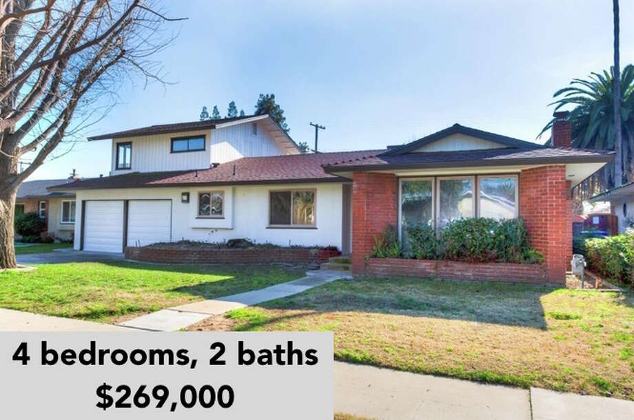 This four-bedroom, two-bathroom ranch home at 2992 E. Garland Ave., in Fresno, Calif., is on the market for $269,000. Listing agent: Maria Rosario Garcia of Better Homes & Gardens Photo: Courtesy Maria Rosario Garcia