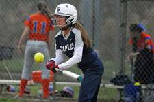 Staples' Ali Green smacks a hit during a game against Danbury on Wednesday.