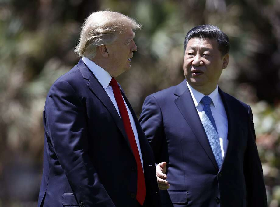 In this April 7, 2017 file photo, President Donald Trump, left, and Chinese President Xi Jinping walk together after their meetings at Mar-a-Lago, in Palm Beach, Fla. Photo: Alex Brandon, Associated Press