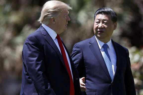 "FILE - In this April 7, 2017 file photo, President Donald Trump, left, and Chinese President Xi Jinping walk together after their meetings at Mar-a-Lago, in Palm Beach, Fla.   China says President Xi has stressed the need for an end to North Korea's nuclear weapons program in a phone discussion with Trump that followed tweets from the U.S. president urging China to play a more active role. Xi told Trump that China insists on peace and stability on the Korean Peninsula and advocates resolving the problem through peaceful means. He said China would maintain ""communication and coordination"" with Washington over it. The two leaders spoke Tuesday night, April 11, 2017, Washington time. (AP Photo/Alex Brandon, File)"