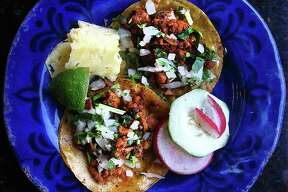 Taco of the Week: Al pastor tacos with pineapple, lime, radishes, cucumber, cilantro and onions from Taquitos West Ave.
