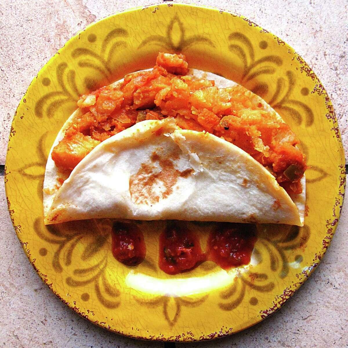 Papas rancheras taco on a handmade flour tortilla from Taquería Jimador.