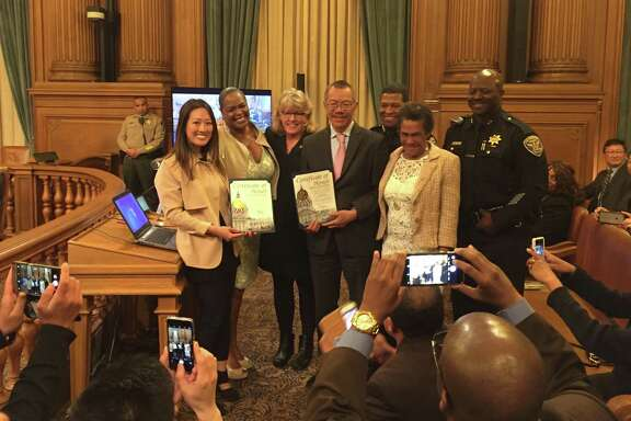 Supervisor Katy Tang; Janet Atchan; Anne Kronenberg, Executive Director, San Francisco Department of Emergency Management; Supervisor Norman Yee; San Francisco Police Chief William Scott; Janet's mother; Deputy Chief Mikali Ali.