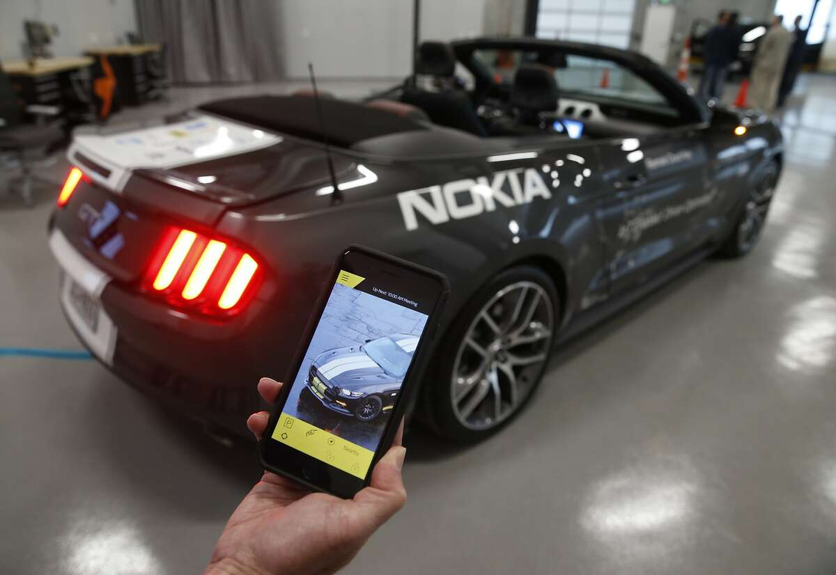 Nokia's Jeff Ligon displays an app-based remote unlocking system for the rental and car sharing markets under development in a collaboration with the Continental Silicon Valley Research and Development Center for automotive technology in San Jose on Wednesday, April 12, 2017.