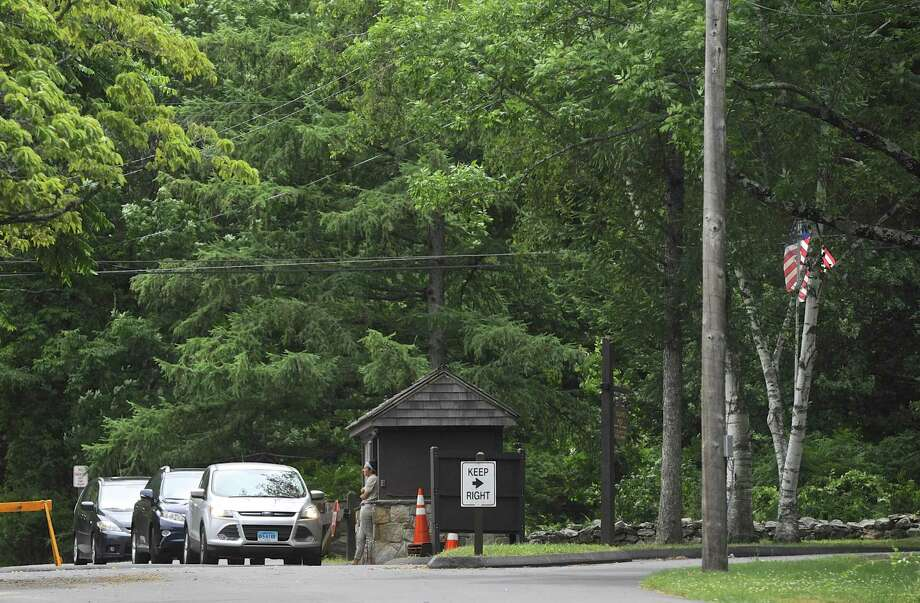 Cars line up at the entrance to Squantz Pond State Park, in New Fairfield, on the first day of the Forth of July Holiday weekend. Saturday, July 2, 2016, in New Fairfield, Conn. Photo: H John Voorhees III / Hearst Connecticut Media / The News-Times