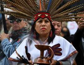 """(FILES) This file photo taken on February 5, 2017 shows Native American and demonstrators marching to the Federal Building in protest against US President Donald Trump's executive order fast-tracking the Keystone XL and Dakota Access oil pipelines, in Los Angeles, California. President Donald Trump on March 24, 2017 gave final approval to the US-Canada Keystone XL oil pipeline, saying it would create jobs and improve America's energy security.  """"It's a great day for American jobs and a historic moment for North America and energy independence,"""" he said.   / AFP PHOTO / Mark RALSTONMARK RALSTON/AFP/Getty Images"""
