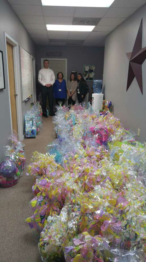 Locals Denis Kobas and Kelci Terry organized the collection of 150 Easter baskets for kids in need. Photo: / Contributed Photo