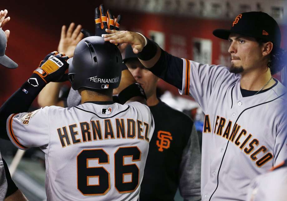 Left fielder Jarrett Parker, right, carries an .071 average into Wednesday night's game. Outfield mate Gorkys Hernandez is hitting .080. Photo: Ross D. Franklin, Associated Press