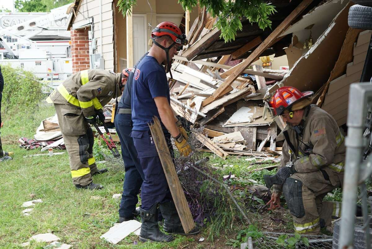 One woman was taken to a nearby hospital after her pickup truck rolled through a home Wednesday April 12, 2017 near the intersection of Hackberry and Glorietta.