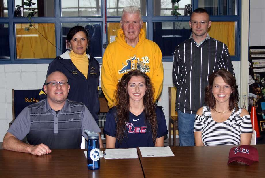 Bad Axe's Mikayla Beeler signed her letter of intent Wednesday with Division II Lee University in Cleveland, Tennessee. The track standout is pictured sitting with parents Mike and Lynette Beeler. Back row, from left, coaches Theresa Byrne, Lee Kahler and Nick Rochefort.