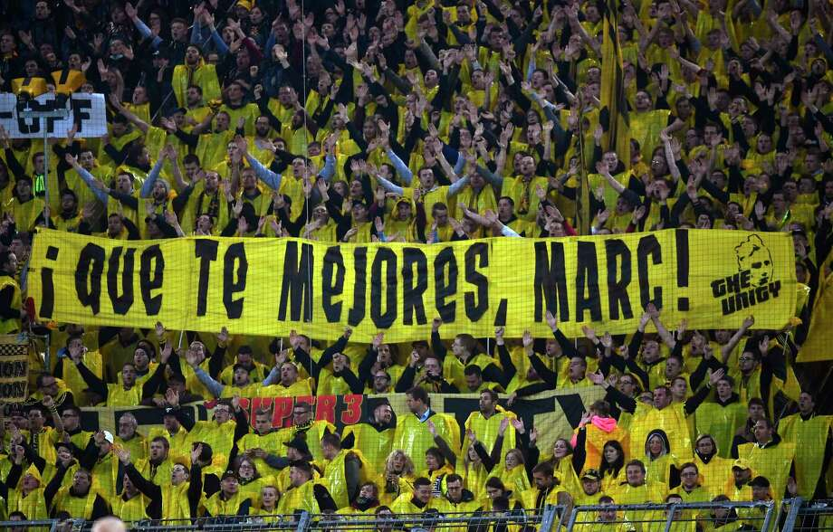 Dortmund fans hold a poster 'Get well, Marc!' during the Champions League quarterfinal first leg soccer match between Borussia Dortmund and AS Monaco in Dortmund, Germany, Wednesday, April 12, 2017. Dortmund's Marc Bartra was injured after a blast outside the Dortmund team bus the day before. (AP Photo/Martin Meissner) Photo: Martin Meissner, STR / Copyright 2017 The Associated Press. All rights reserved.