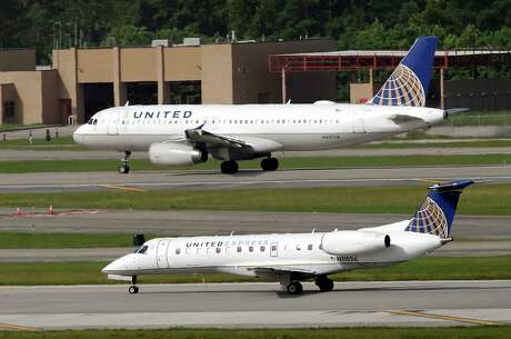 FILE - In this July 8, 2015, file photo, United Airlines and United Express planes prepare to takeoff at George Bush Intercontinental Airport in Houston. After a man is dragged off a United Express flight on Sunday, April 9, 2017, United Airlines becomes the butt of jokes online and on late-night TV. Travel and public-relations experts say United has fumbled the situation from the start, but it's impossible to know if the damage is temporary or lasting. Air travelers are drawn to the cheapest price no matter the name on the plane. (AP Photo/David J. Phillip, FIle)