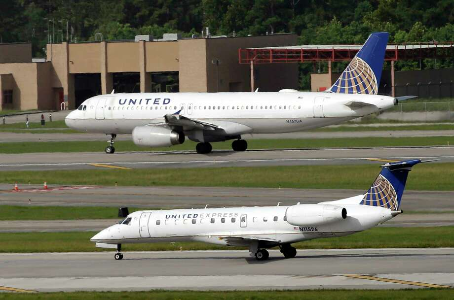 In this July 8, 2015, file photo, United Airlines and United Express planes prepare to takeoff at George Bush Intercontinental Airport in Houston. (AP Photo/David J. Phillip, FIle) Photo: David J. Phillip, STF / Copyright 2016 The Associated Press. All rights reserved.