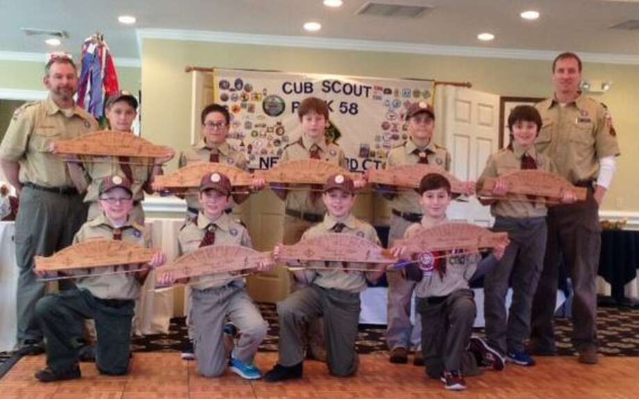 Webelo 2 Scouts from Cub Scout Pack 58 in New Milford recently received their Arrow of Light, the highest ranking award in Cub Scouts. Above, leaders Paul Natoli, back left, and Chris Roberts, back right, join Webelo 2 Scouts at the Arrow of Light ceremony, from left to right, in front, Ty Cossari, Ben Schipul, Michael Natoli and Morgan Marano, and in back, Christopher Gardner, Caleb Cerra, Connor Ciaglo, Evan Lovejoy and Waylon Jayne. Missing is Ryan Roberts. Photo: Courtesy Of Cub Scout Pack 58 / The News-Times Contributed