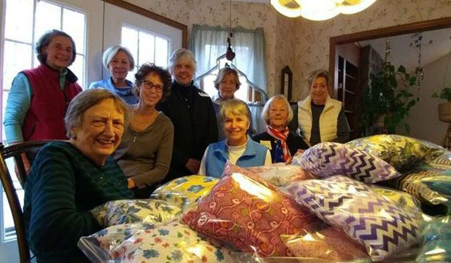 The Woman's Club of Danbury and New Fairfield recently sewed items to support the Danbury Hospital Cancer Center. Each year a group of women join club members in making the items for a community project. Ladies first made 100 breast and abdomen pillows due to their urgent need, followed by 108 chemo caps in batches over the last five months. From left to right are, in front, Constance Pardey, Thayer Cipolla, Donna Apple and Roberta Anderson, and in back, Adriane Robison, Maureen Gianni, Noreen Toscano, BG Brown and Joann McDonald. Missing are Laureen Curry, Cassie Dunn, Cathleeen Elliott, Katie Fanti, Jan Maira Jagush and Dorothy Mutz. Photo: Contributed Photo / Contributed Photo / The News-Times Contributed