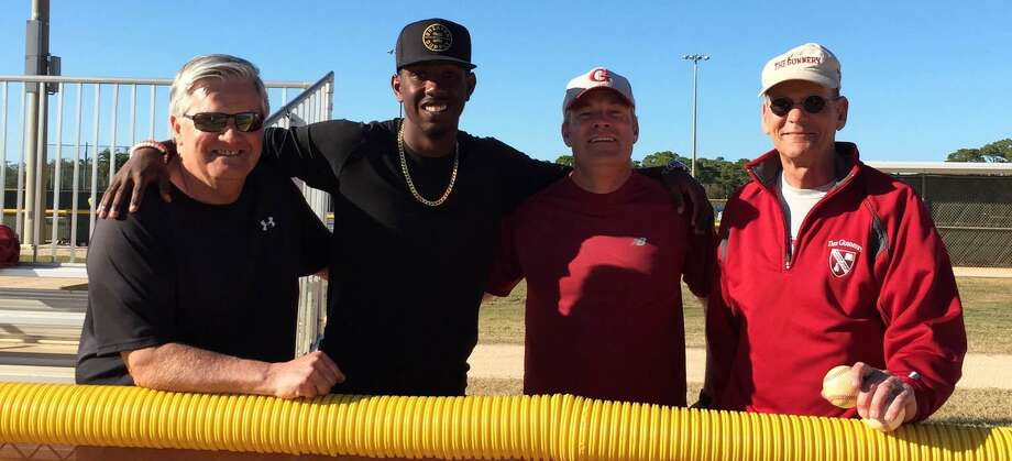 Mets' draftee Justin Dunn of the Gunnery School's class of 2013, second from left, visits with the school's baseball coaches, from left to right, Jeff Trundy, Richard Martin and Ed Small during the Gunnery boys' baseball team's annual visit to Florida for spring training. Photo: Courtesy Of The Gunnery / The News-Times Contributed