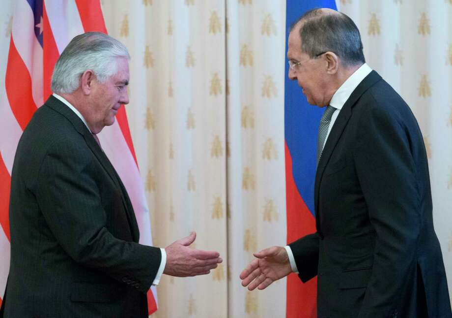 US Secretary of State Rex Tillerson, left, and Russian Foreign Minister Sergey Lavrov shake hands prior to their talks in Moscow, Russia, Wednesday, April 12, 2017. Tillerson's Moscow talks hinge on new US leverage over Syria. (AP Photo/Alexander Zemlianichenko) Photo: Alexander Zemlianichenko, STF / Copyright 2017 The Associated Press. All rights reserved.