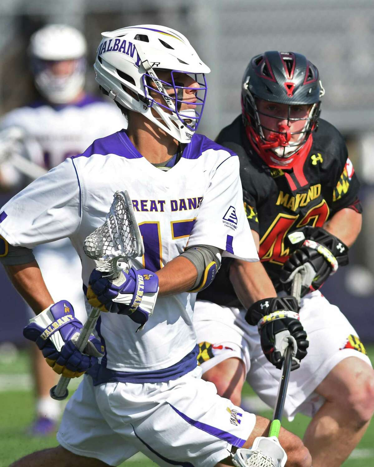 University at Albany's Adam Osika, left, is defended by Maryland's Curtis Corley during a lacrosse game on Wednesday, April 12, 2017 in Albany, N.Y. (Lori Van Buren / Times Union)