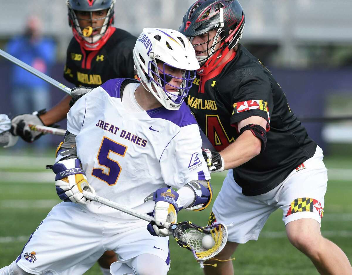 University at Albany's Connor Fields, left, is defended by Maryland's Tim Muller during a lacrosse game on Wednesday, April 12, 2017 in Albany, N.Y. (Lori Van Buren / Times Union)