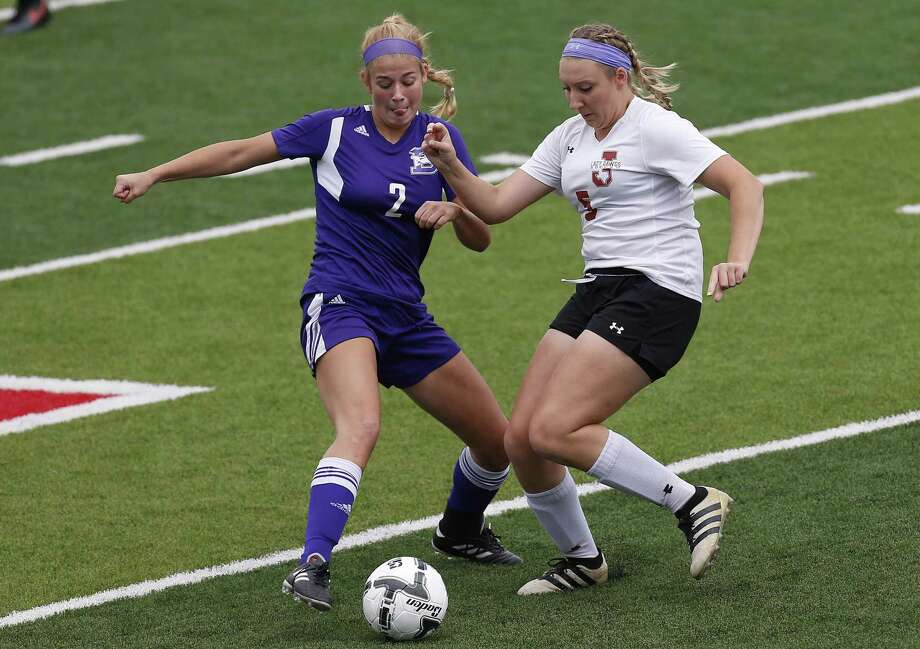 Boerne's Mary Kate Snelling (2) and Jasper's Kylee Dominy (5) battle for the ball during the UIL soccer class 4A semifinals at Birkelbach Field, Georgetown, Wednesday, April. 12, 2017. (Stephen Spillman) Photo: Stephen Spillman / Stephen Spillman / stephenspillman@me.com Stephen Spillman