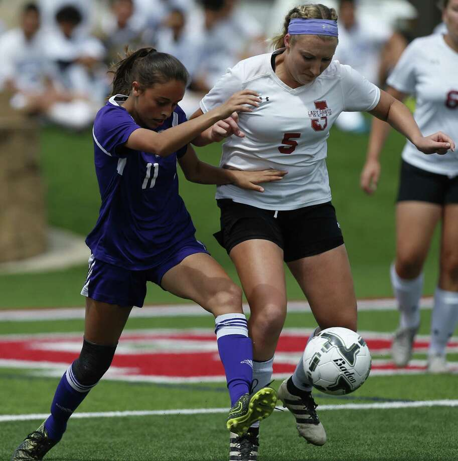 Boerne's Brianna Barrera (11) and Jasper's Kylee Dominy (5) battle for the ball during the UIL soccer class 4A semifinals at Birkelbach Field, Georgetown, Wednesday, April. 12, 2017. (Stephen Spillman) Photo: Stephen Spillman / Stephen Spillman / stephenspillman@me.com Stephen Spillman