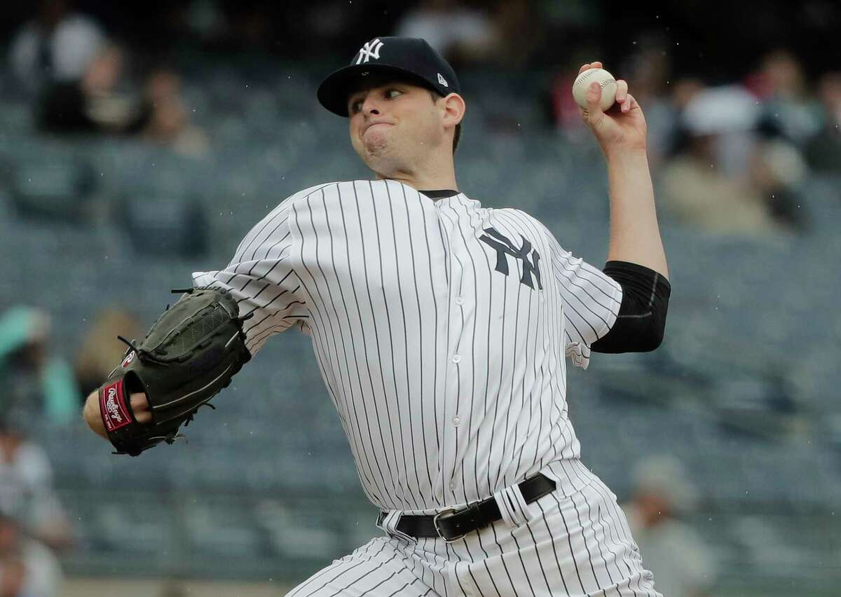 New York Yankees pitcher Jordan Montgomery delivers against the Tampa Bay Rays during the first inning of a baseball game, Wednesday, April 12, 2017, in New York. (AP Photo/Julie Jacobson) ORG XMIT: NYJJ101