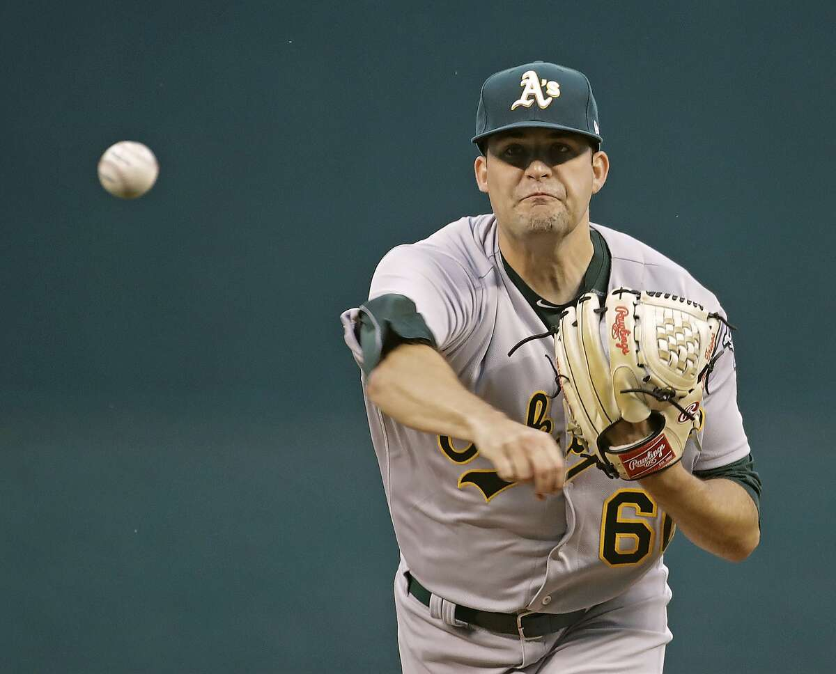 Oakland Athletics starting pitcher Andrew Triggs throws during the first inning of the team's baseball game against the Kansas City Royals on Wednesday, April 12, 2017, in Kansas City, Mo. (AP Photo/Charlie Riedel)