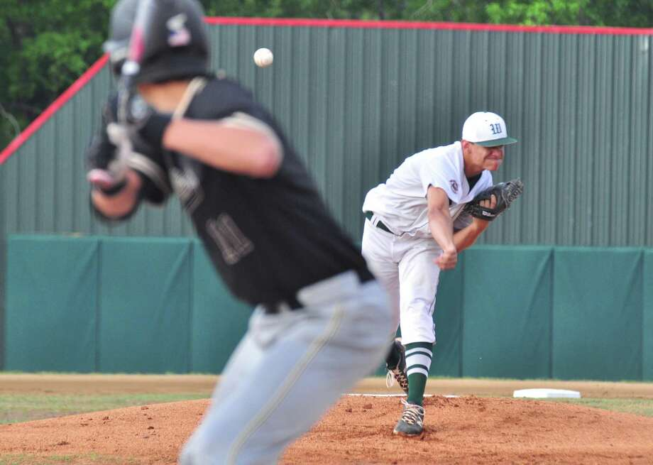 The Woodlands pitcher Cole Sichley fires a pitch against Conroe on Wednesday at Scotland Yard in The Woodlands. Photo: Keith MacPherson