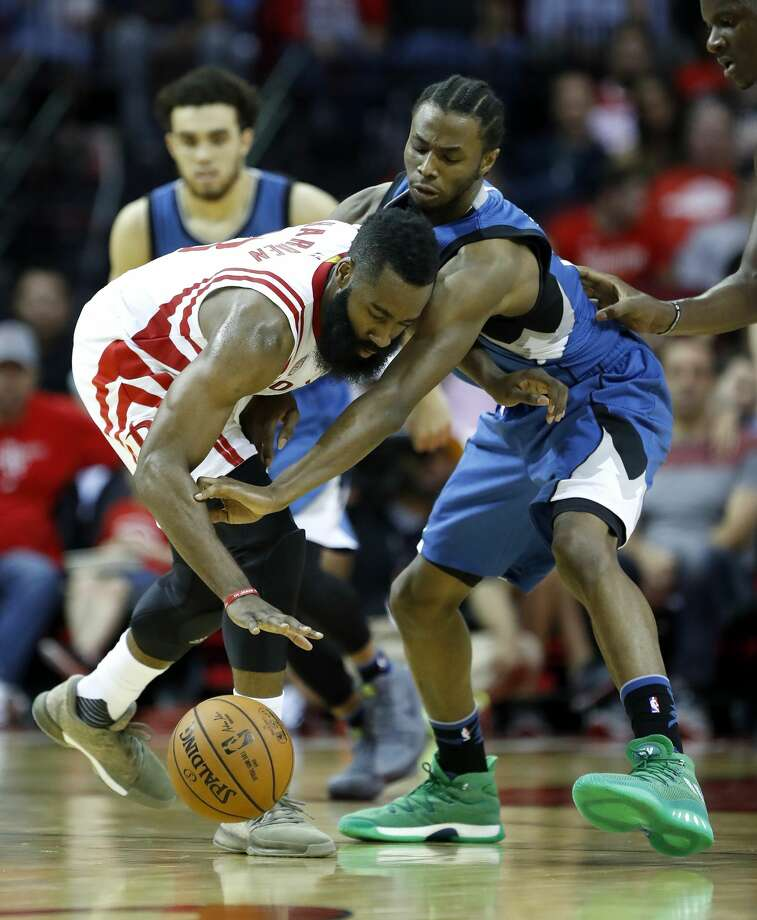 Minnesota Timberwolves forward Andrew Wiggins (22) and Houston Rockets guard James Harden (13) battle for a loose ball during the second half of an NBA basketball game at the Toyota Center, Wednesday, April 12, 2017, in Houston. ( Karen Warren / Houston Chronicle ) Photo: Karen Warren/Houston Chronicle
