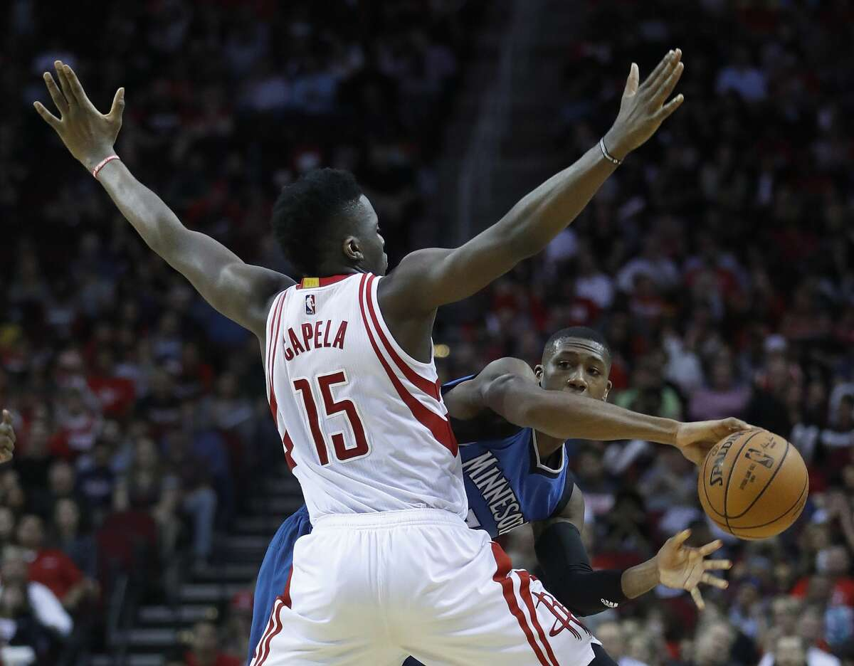 Minnesota Timberwolves guard Kris Dunn (3) tries to pass the ball around Houston Rockets center Clint Capela (15) during the second half of an NBA basketball game at the Toyota Center, Wednesday, April 12, 2017, in Houston. ( Karen Warren / Houston Chronicle )