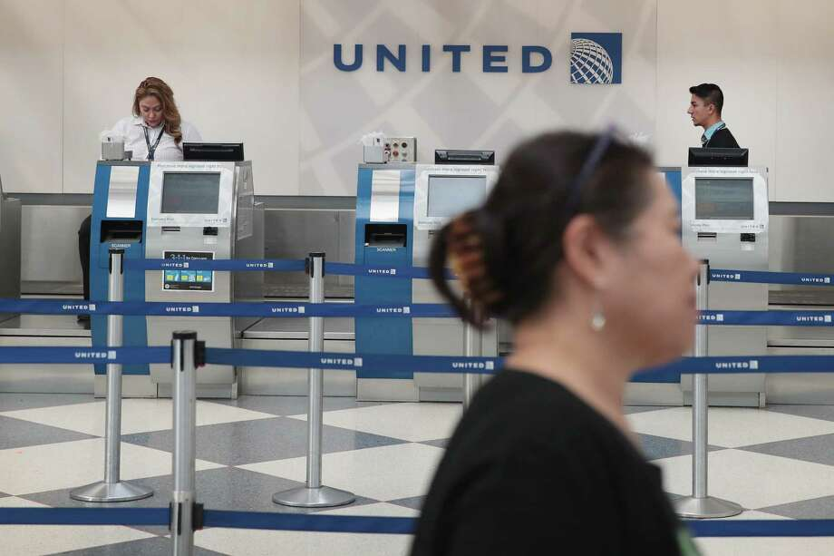 United Airlines has issued a series of apologies and promised to review its policies after a passenger in Chicago was dragged from a flight. Photo: Scott Olson, Staff / 2017 Getty Images