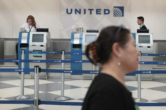 United Airlines has issued a series of apologies and promised to review its policies after a passenger in Chicago was dragged from a flight.