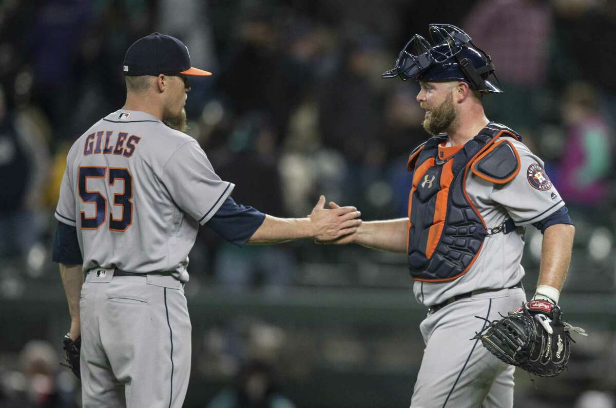Catcher Brian McCann, right, congratulates Ken Giles after the closer's shaky outing Tuesday, when he turned a 7-3 lead into a 7-5 nailbiter.