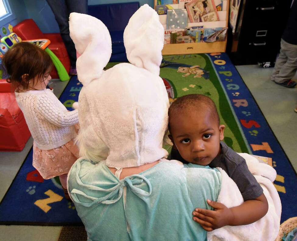 The Spring Bunny played by Katheryn Capalbo gets a warm hug from two year old Emanuel Webster during class time at the Unity Sunshine III pre-school at the YWCA Wednesday April 12, 2017 in Troy, N.Y. (Skip Dickstein/Times Union)