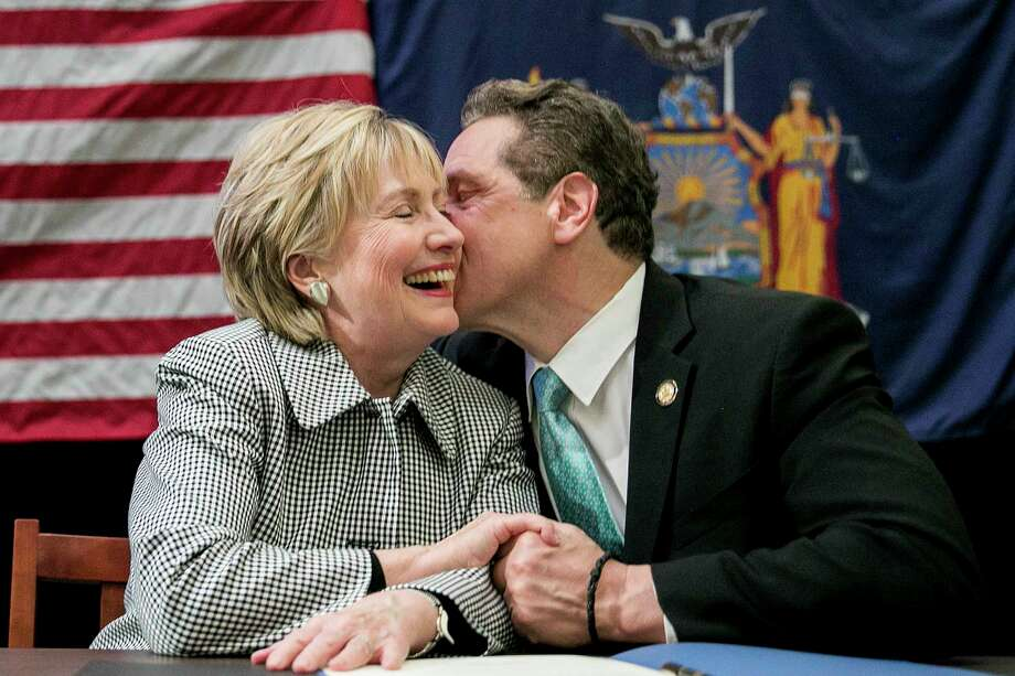 New York Gov. Andrew Cuomo and Hillary Clinton during a bill-signing event for the Excelsior Scholarship program, at LaGuardia Community College in New York, April 12, 2017.  (Sam Hodgson/The New York Times) ORG XMIT: XNYT31 Photo: SAM HODGSON / NYTNS
