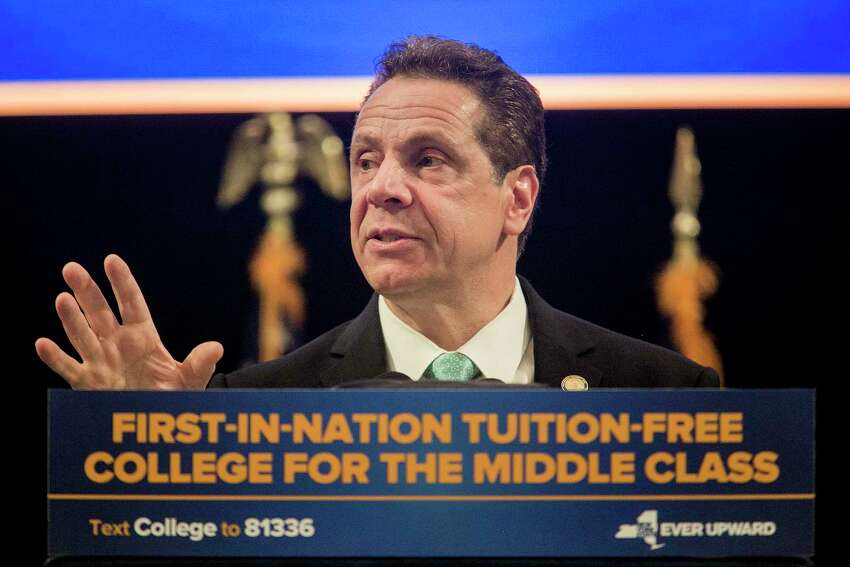 New York Gov. Andrew Cuomo speaks during a bill-signing event for the Excelsior Scholarship program, at LaGuardia Community College in New York, April 12, 2017. Hillary Clinton joined Cuomo on Wednesday.