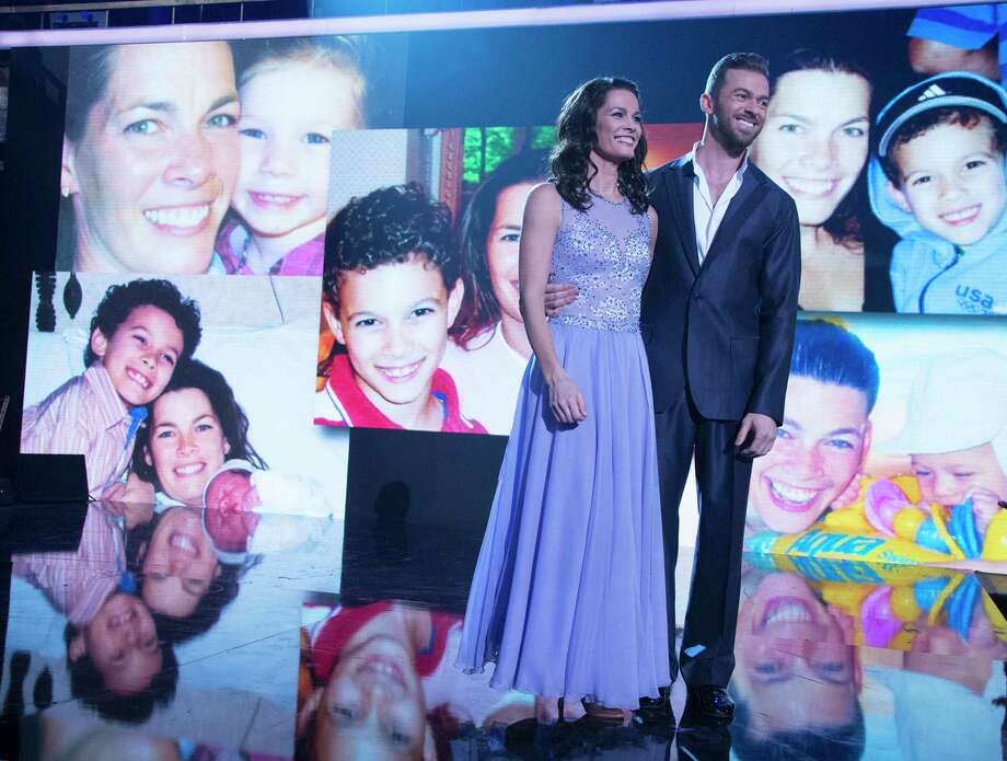 "In this April 10, 2017 photo released by ABC, former Olympic figure skater Nancy Kerrigan appears with her dance partner Artem Chigvintsev as photos of Kerrigan with her children appear on a screen during the competition series, ""Dancing with the Stars.""  Kerrigan opened up about her personal struggles after having six miscarriages in an eight-year span. (Eric McCandless/ABC via AP) ORG XMIT: NYET310 Photo: Eric McCandless / © 2017 American Broadcasting Companies, Inc. All rights reserved"